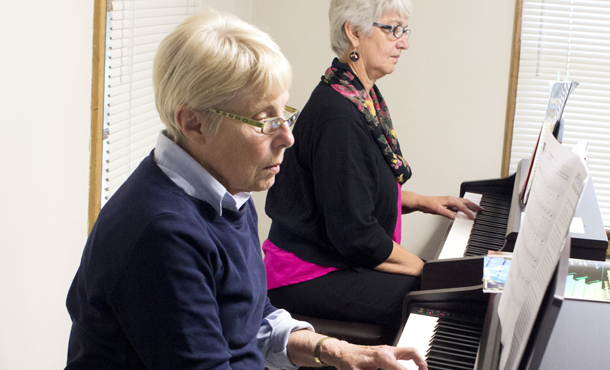 How do adults learn the piano at a faster pace?